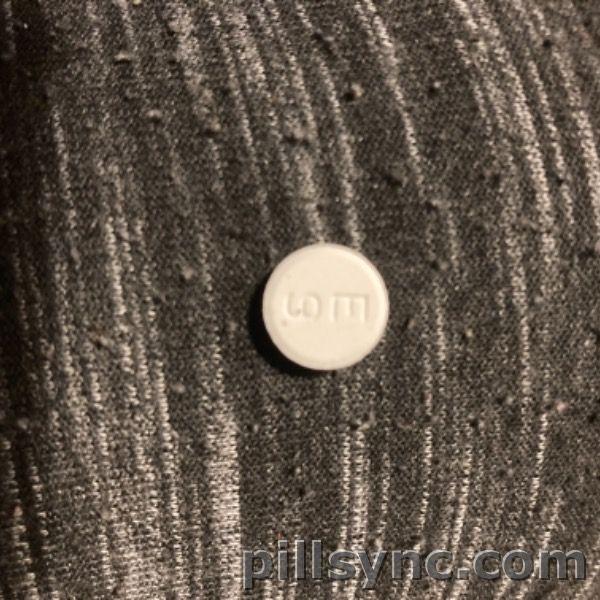 ROUND WHITE E 9 baclofen tablet